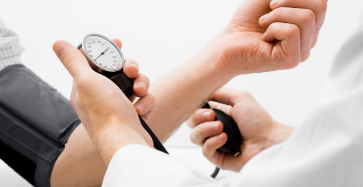 Person having blood pressure checked