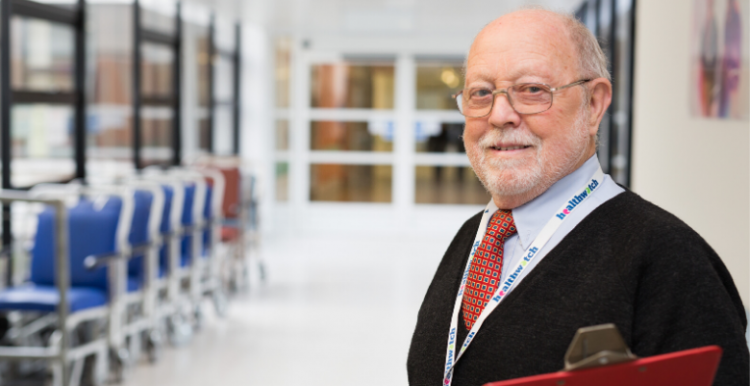 older man in hospital corridor