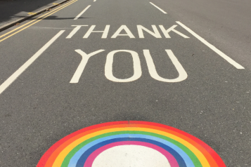 "Road with ""thank you"" written on and NHS rainbow"