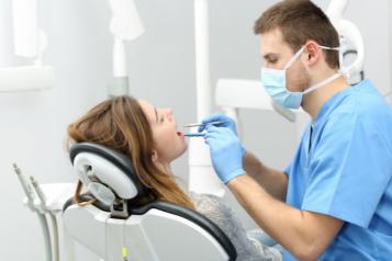 Dentist examining patients teeth