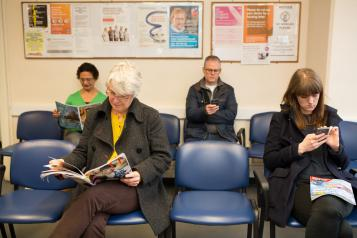 Group of people sitting in waiting room