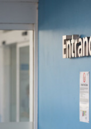 Entrance sign in a hospital corridor