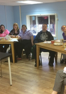 Group of volunteers with learning disabilities taking part in a training session